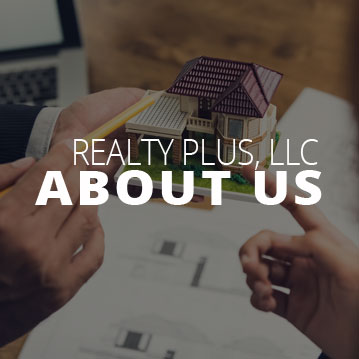 Client and Real Estate Agent looking over house plans and documents | About Realty Plus, LLC